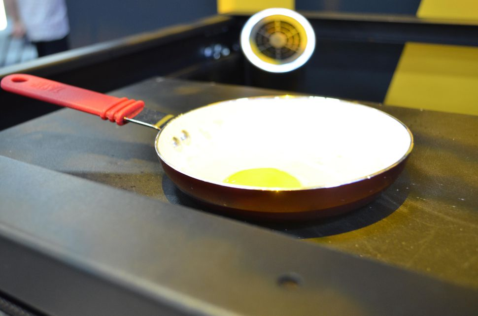 This egg is being cooked on top of a router that